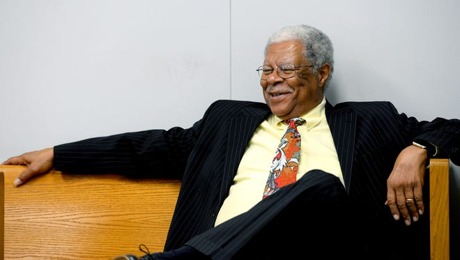 Former Ingham County Prosecutor Stuart Dunnings III laughs as he talks with other people in the gallery as he waits for his preliminary hearing Tuesday, August 2, 2016, in Judge Michael Klaeren's courtroom at the Jackson County Courthouse. Dunnings pleaded guilty to two prostitution-related charges, 13 other charges were dismissed as part of the plea deal.