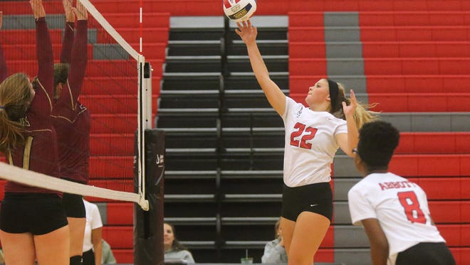 Stewarts Creek's Taylor Townley (22) hits the ball over the net during a game against Riverdale, on Tuesday.