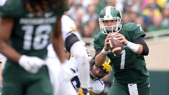 Senior quarterback Tyler O'Connor looks to pass during the game against Michigan on Saturday, Oct. 29, 2016 at Spartan Stadium in East Lansing. Michigan defeated Michigan State, 32-23.