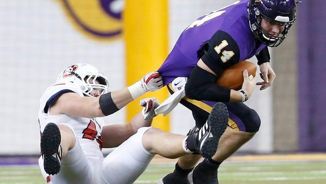 South Dakota's Darin Greenfield tackles Northern Iowa quarterback Eli Dunne during game action at the UNI-Dome in Cedar Falls, Iowa, Saturday, Nov. 4, 2017.
