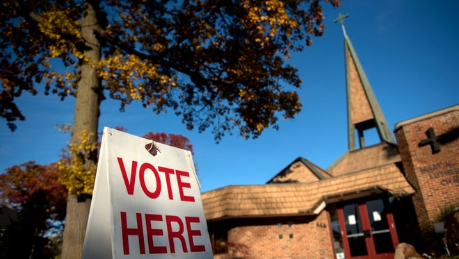 A sign outside the Martin Luther Chapel alerts residents of the polling place on Tuesday, Nov. 7, 2017, in East Lansing.
