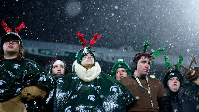 Michigan State fans wear antlers as the snow falls during the fourth quarter on Saturday, November 18, 2017, at Spartan Stadium in East Lansing.