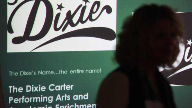 Lori Nolen, Executive Director of The Dixie Carter Performing Arts Center, talks with Huntingdon High School art students about helping to design new signage for the outside of the center, Monday, Jan. 8.