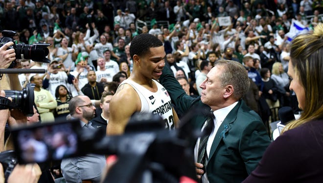 Michigan State head coach Tom Izzo, right, hugs Miles Bridges after the game on Saturday, Feb. 10, 2018, at the Breslin Center in East Lansing. The Spartans beat Purdue 68-65.