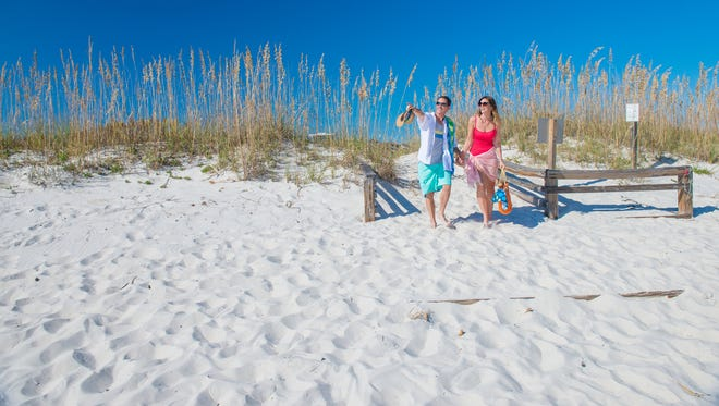 A young couple enjoys the beach in Pensacola.