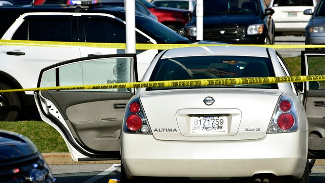 Police tape surrounds the scene where a 3-year-old girl accidentally shot and wounded her pregnant mother in a car parked outside a northwestern Indiana thrift store on Tuesday, April 17, 2018. The shooting happened Tuesday afternoon in Merrillville, Ind., as the girl, a 1-year-old boy and her mother waited in the car while the woman's boyfriend was inside the store. Police say the man is the girl's father and apparently left the loaded gun in the car.