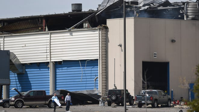A view of some of the damage seen from the outside Meridian Magnesium Products of America in Eaton Rapids, Michigan, Wednesday afternoon, May 2, 2018.   The fire is still burning but is contained.  Officials say two employees were injured but have been released from the hospital.  About six cars were also damaged by the fire according to a worker.  [Matthew Dae Smith/Lansing State Journal]