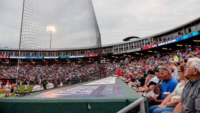 Fans are shielded by the extended netting along the third base line during the Midwest League All-Star game on Tuesday, June 19, 2018, at Cooley Law School Stadium in Lansing.