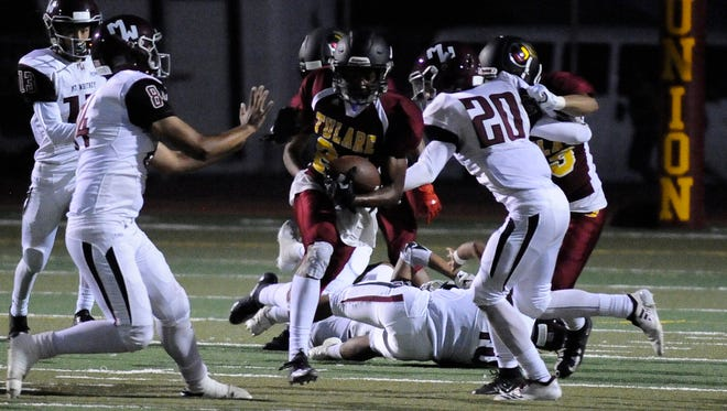 Tulare Union's Randy Jordan Jr. returns a kickoff against Mt. Whitney in Week 1.