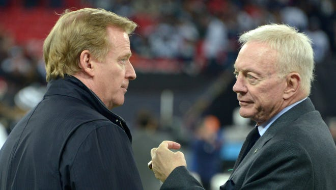 Dallas Cowboys owner Jerry Jones (right) is threatening to sue the league over NFL commissioner Roger Goodell's contract negotiations.