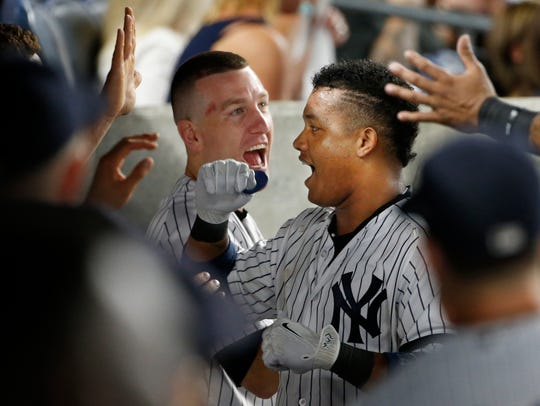 New York Yankees Todd Frazier, left, celebrates with