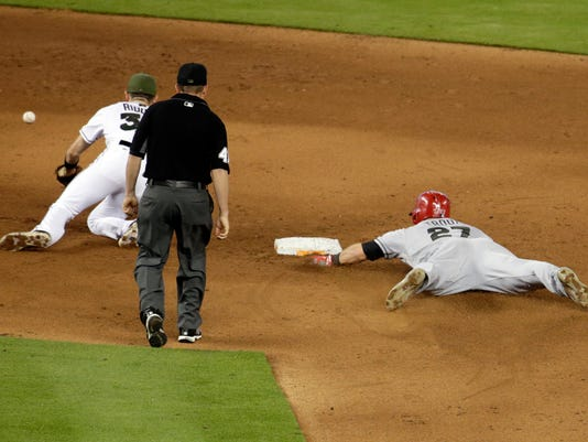 Los Angeles Angels' Mike Trout (27) steals second as the ball gets away from Miami Marlins shortstop JT Riddle during the fifth inning of an interleague baseball game, Sunday, May 28, 2017, in Miami. Trout injured his thumb on the play. (AP Photo/Lynne Sladky)