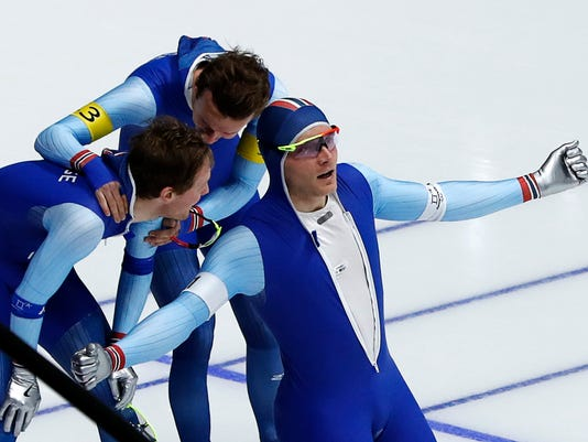 Gold medalist team Norway with Havard Bokko, front, Simen Spieler Nilsen, rear right, and Sverre Lunde Pedersen celebrates after the men's team pursuit final speedskating race at the Gangneung Oval at the 2018 Winter Olympics in Gangneung, South Korea, Wednesday, Feb. 21, 2018. (AP Photo/Eugene Hoshiko)