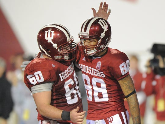 FILE – Former IU center Will Matte (left, celebrating with Demarlo Belcher) still has a lasting effect on Hoosiers' offensive line.