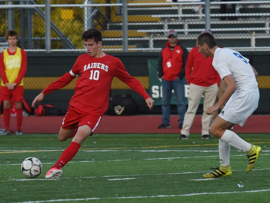 Red Hook's Colin Sullivan, left, winds up a kick during