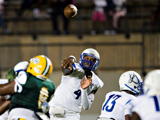 Sidney Lanier's James Foster throws a pass during the AHSAA football game at Cramton Bowl in Montgomery, Ala., on Friday, Sept. 29, 2017.