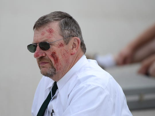 Dale Hutjen volunteers as a victim of a plane crash during the airport emergency management drill at Austin Straubel International Airport, Wednesday, August 20, 2014.