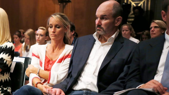 Kevin Turner, right, a former NFL fullback now suffers from Lou Gehrig's disease.