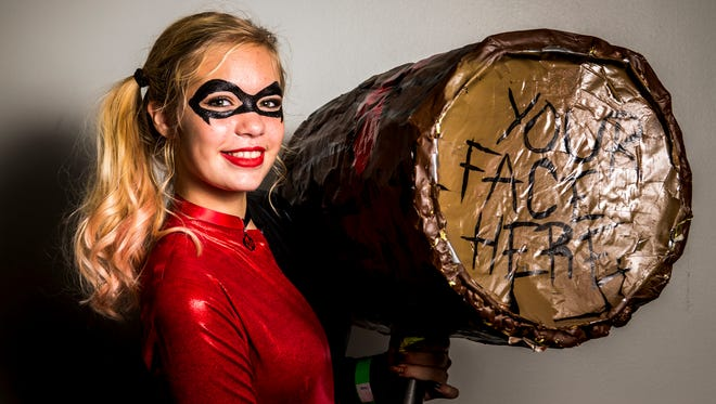 Polly Brinkman,16, of Taylor Mill, as Harley Quinn poses for a portrait at the Cincinnati Comic Expo at Duke Energy Convention Center Saturday, September 24, 2016.