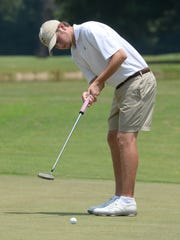 Reed Sykes puts in for parr on three during his match against Patrick Blunt. Sykes defeated last years champion Pete D'Arcy in the second round of play at the Shreveport City Amateur Friday afternoon..