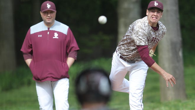 Iona Prep pitcher Samuel Bello (15) warms up prior to their game against Stepinac at Iona Prep High School in New Rochelle on Friday, May 12, 2017.