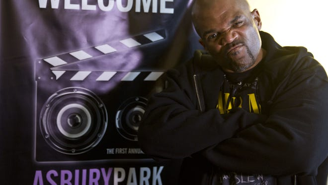 Darryl McDaniels of RUN-DMC, poses next to a banner promoting the 2015 Asbury Park Music in Film Festival on April 10, 2015.