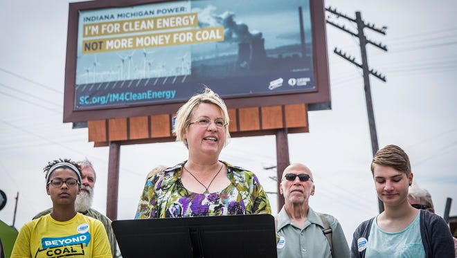 Jennifer Rice-Snow of High Street United Methodist Church advocates for clean energy during a press conference to announce an advertising campaign.