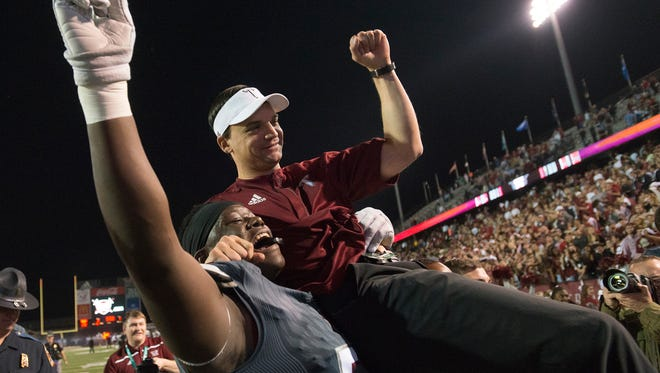 Troy Trojans offensive lineman Tristan Crowder (54) lifts up Troy Trojans head coach Neal Brown after the NCAA football game between against the Appalachian State Mountaineers and Troy Trojans on Saturday, Nov. 12, 2016, in Troy, Ala. Troy Trojans defeated Appalachian State Mountaineers 28-24. Montgomery Advertiser/Albert Cesare
