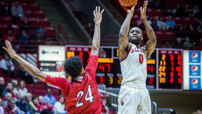 Ball State's Francis Kiapway shoots past Miami's defense during their game at Worthen Arena Tuesday, Jan. 10, 2016.