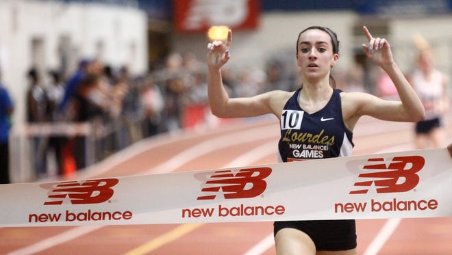 Our Lady of Lourdes' Caroline Timm finishes in first place with a 4:56.25 time in the mile run during the 22nd annual New Balance Games at The Armory New Balance Track & Field Center in New York on Saturday, January 21, 2017.