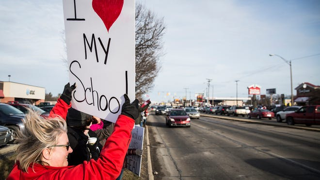 "Hundreds of teachers, students and community members gathered for the ""Save MCS"" rally at the intersection of McGalliard Road and Wheeling Avenue Feb. 9."