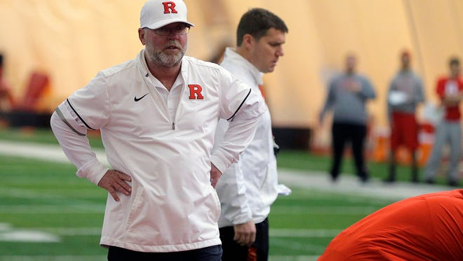 Rutger's football offensive coordinator Jerry Kill and Rutgers' head coach Chris Ash coach during the first Rutgers spring football practice in the practice bubble in Piscataway, NJ Thursday March 23, 2017.