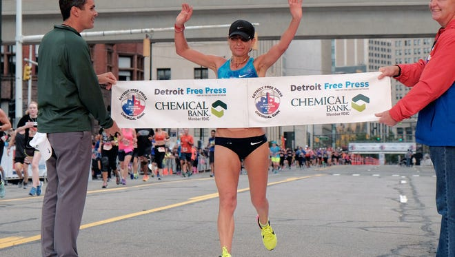 Valentyna Poltavska finishes 1st for the women during the 40th Annual Detroit Free Press/Chemical Bank Marathon in Detroit on Sunday, Oct. 15, 2017.