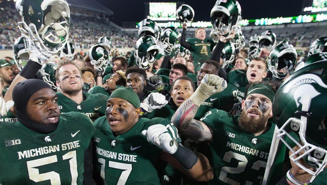 Michigan State Spartans celebrate the 27-24 win against Penn State Saturday, November 4, 2017 at Spartan Stadium in East Lansing.