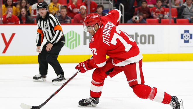Red Wings left wing Andreas Athanasiou (72) skates with the puck just before scoring during the second period of the Wings' 3-2 loss on Tuesday, Feb. 20, 2018, at Little Caesars Arena.