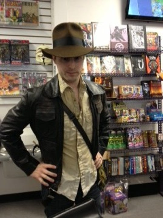 """Alex Levitsky, manager at Planet X Comics and Collectibles, dressed as Indiana Jones as preparation for Hurricane Sandy. """"If you're dressed as Indiana Jones, there's nothing you can't survive,"""" Levitsky said."""