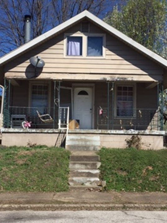 County democratic chairman helping friend with blighted homes for Home builders in iowa