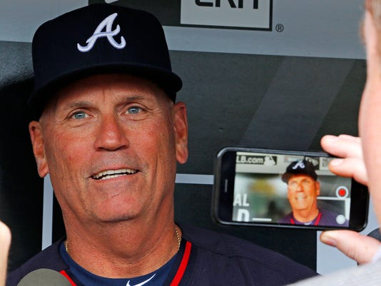 Atlanta Braves interim manager Brian Snitker talks with reporters in the dugout before a baseball game against the Pittsburgh Pirates in Pittsburgh, Tuesday, May 17, 2016. The Braves fired manager Fredi Gonzalez, Tuesday, May 17, 2016.  (AP Photo/Gene J. Puskar)