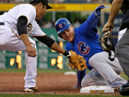 Chicago Cubs' Anthony Rizzo, center, slides into third ahead of the attempted tag by Pittsburgh Pirates third baseman Jung Ho Kang, left, with a triple in the third inning a baseball game in Pittsburgh, Saturday, July 9, 2016. (AP Photo/Gene J. Puskar)