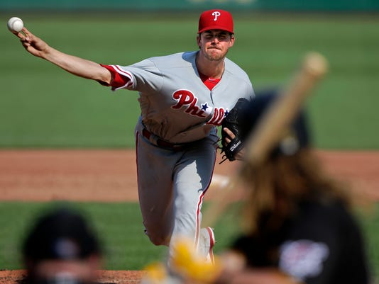 Philadelphia Phillies starting pitcher Aaron Nola delivers during the third inning of a baseball game against the Pittsburgh Pirates in Pittsburgh, Saturday, July 23, 2016. (AP Photo/Gene J. Puskar)