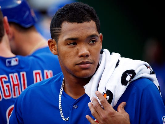 """FILE - In this Aug. 4, 2015, file photo, Chicago Cubs' Addison Russell stands in the dugout during a baseball game against the Pittsburgh Pirates in Pittsburgh. Major League Baseball is looking into a domestic violence accusation against Russell.  His wife, Melissa, posted a photo Wednesday on Instagram with a caption suggesting he was unfaithful to her. In another post, a user named carlierreed and described by Melissa as a close friend accused Russell of """"mentally and physically abusing her."""" The posts have been deleted. Russell issued a statement Thursday, June 8,2 017, that said: """"Any allegation I have abused my wife is false and hurtful. For the well-being of my family, I'll have no further comment.""""  (AP Photo/Gene J. Puskar, File)"""