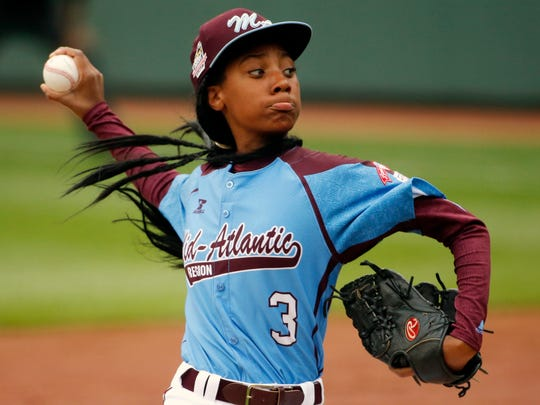 Pennsylvania's Mo'ne Davis delivers a pitch in the fifth inning against Tennessee during a baseball game in United States pool play at the Little League World Series tournament in South Williamsport, Pa., on Aug. 15, 2014. Pennsylvania won 4-0 with Davis pitching a complete game two-hit shutout.