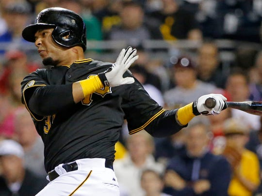Pittsburgh Pirates' Jose Tabata drives in the tying run with a sacrifice fly off Washington Nationals starting pitcher Stephen Strasburg during the seventh inning of a baseball game in Pittsburgh, Saturday, May 24, 2014. (AP Photo/Gene J. Puskar)