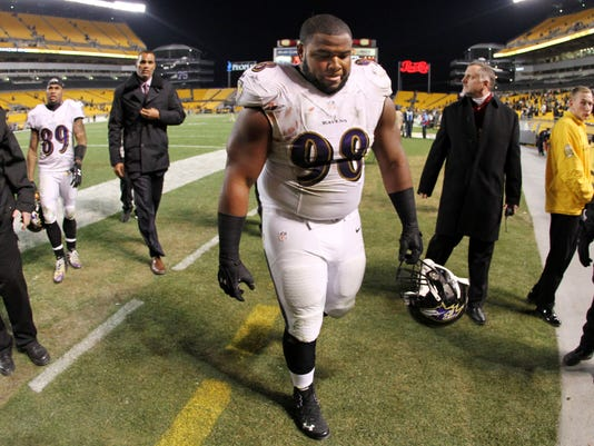 Baltimore Ravens nose tackle Brandon Williams (98) walks off the field after a 43-23 loss to the Pittsburgh Steelers in an NFL football game in Pittsburgh, Monday, Nov. 3, 2014. (AP Photo/Gene J. Puskar)