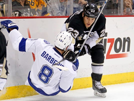Pittsburgh Penguins' Steve Downie (23) collides with Tampa Bay Lightning's Mark Barberio (8) during the second period of an NHL hockey game in Pittsburgh Monday, Dec. 15, 2014.(AP Photo/Gene J. Puskar)