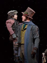 Jonas Hinsdale and Creed Garnick play Tiny Tim and Bob Cratchit.