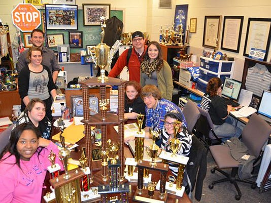 MTSU Debate Team w Trophies 2015-06.jpg