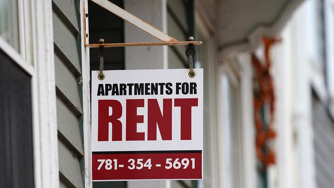 "A ""for rent"" sign in downtown Portsmouth."