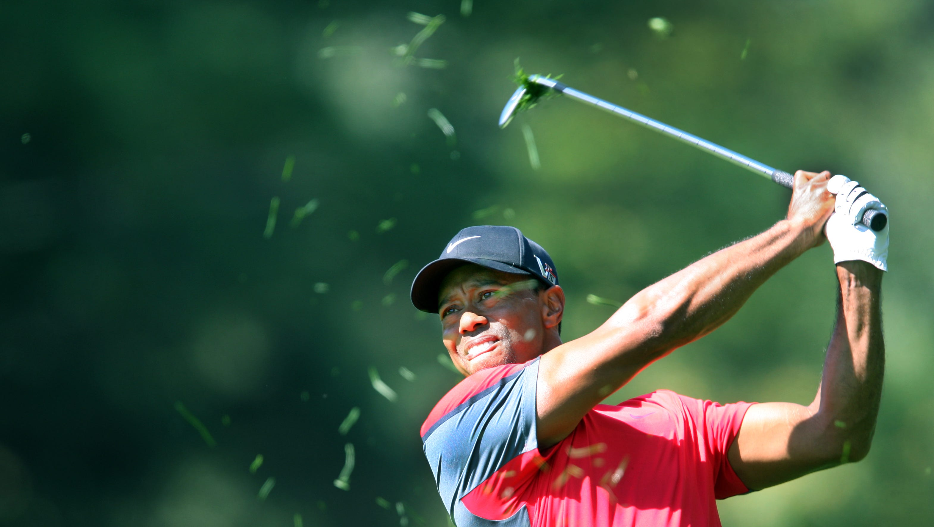 Tiger Woods swings on the 1 fairway during the final round of the 95th PGA championship at Oak Hill Country Club.
