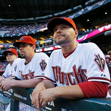 Cody Ross (right) looks on during their Opening Day MLB game game against the  San Francisco Giants Monday, March 31, 2014 in Phoenix.